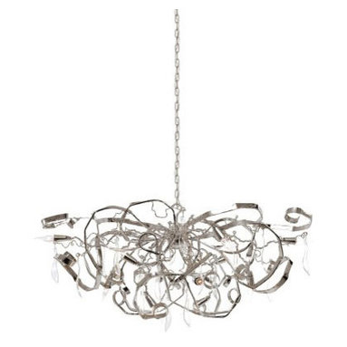 Delphinium Oval Chandelier by Brand Van Egmond - Delphinium Oval chandelier, featuring a diffuser of hand-sculpted metal, is full of gaiety and elegance. Draping rib bands and curvilinear strands of gleaming gloss sweep outwards to form an oval and downwards into a dome-shape. Large, clear curvi-form crystals drop down throughout, along with flame-tip lamps positioned at various angles, complete this festive luminary. The diffuser suspends by a chain from a domed canopy. Available in a small, medium, large and extra large size. Also available in a wall sconce, ceiling flush mount, table lamp, floor lamp, pendant and suspension version. Small and medium sizes require (12) large requres (16) and extra large requires (20) 40 watt, 120 volt, CA10 flame tip candelabra incandescent lamps not included. General light distribution. Made in the Netherlands. Small: 47.2W x 21.65H x 23.6L. Medium: 55.12W x 21.65H x 27.56L. Large: 63W x 21.65H x 31.5L. Extra large: 78.7W x 27.65H x 39.4L. All sizes require a special junction box for fixtures weighing 50+ lbs.