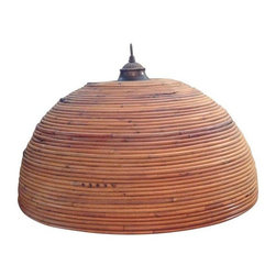 Pre-owned Vintage Bent Bamboo Hanging Pendant Lamp - A vintage boho-hippie-chic bamboo hanging lamp. The lamp features a beehive stacked ring pattern, aged brass patina hardware and an opaque white glass globe on the interior. This lamp is hard wired but could easily be modified to a plug. There are natural variations in the bamboo color that enhance the rich look of this unique lighting source.     Please note, there is some crackling to the paint on the top interior ring that holds the glass globe (shown in photos).