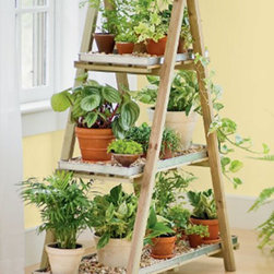 A-Frame Plant Stand Set - I am constantly cleaning water off my floor after watering plants. This planter has industrial looking metal trays to protect your floors inside and can be moved outside in the warmer months because the wood has been treated - don't worry - it's eco-friendly and non-toxic.