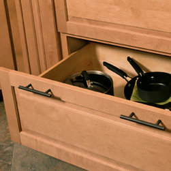 CliqStudios.com - Pots and Pans Storage - Two deep drawers with heavy duty full extension runners provide the perfect storage space for small cooking pots, large pans, woks, double boilers, stock and pasta pots. The extra deep drawers even allow for crock pot storage and organization of cooking lids.  Using drawers instead of doors works beautifully with transitional and modern design, and complements accessible design, universal design and aging in place design.