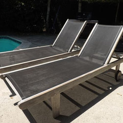 SOLD! modern teak lounge chairs - This is a really cool pair of chaise lounge chairs for your patio, which were purchased at the high end retailer Robb & Stuckey in Florida.