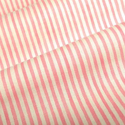 Pinstripe Fabric in Pink - Pinstripe Fabric in Pink is a 100% cotton, European fabric that works well for drapery, upholstery, or bedding and pillow fabric with a bright, cheery color perfect for summer designs. Made in the UK, this fabric has a width of 54″ and a repeat of 25″ X 0.5″. Machine washable in cold water, do not bleach. Warm iron if needed. Preferably dry cleaned.