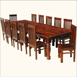 "Large Solid Wood Rustic Dining Table Chair Set For 12 People - Enjoy classic elegance with our 130"" Large Solid Wood Dining Table & Chair Set For 12 People. The entire set is handmade with solid Indian Rosewood, a hardwood favored by craftsmen for its strength, durability, and unique wood grain patterns. The table is enhanced with classic column legs, one on each corner and a fifth leg in the center for extra support. The chairs have classic tall backs, oversized front square legs, and three sided stretchers for added stability."