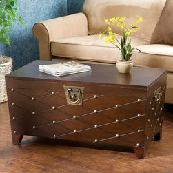 Wildon Home � - Calvert Trunk Coffee Table with Lift-Top - Merging sophisticated style and abundant storage space, this combination trunk and coffee table features a beautiful grooved diamond pattern that wraps around the entire body of the trunk accented by decorative nail heads at the intersections, for wholly attractive finish. Features: -Metal hardware handles.-Antique gold nail heads.-Each nail head is placed at the intersections of the grooved diamond pattern lines that wrap around the body of the trunk.-Lid lifts to reveal an extra large storage area.-Ideal for pillows, blankets and other household necessities.-Decorative padlock latch.-Worldly appeal.-Pine veneer over MDF construction.-Deep espresso stain finish.-Distressed: No.Dimensions: -Inside storage dimensions: 12'' H x 35'' W x 17'' D.-Overall dimensions: 17.25'' H x 37'' W x 20.5'' D.-Overall Height - Top to Bottom: 17.25.-Overall Width - Side to Side: 37.-Overall Depth - Front to Back: 20.5.-Overall Product Weight: 60.95 lbs.