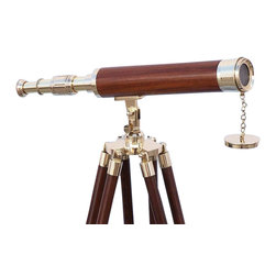 """Handcrafted Model Ships - Floor Standing Brass/Wood Harbor Master Telescope 42"""" - Floor Standing Telescope - The Hampton Nautical 42"""" Brass/ Wood Telescope is a beautiful brass refractor telescope mounted on a wooden tripod. This telescope is a fully functioning nautical masterpiece that adds class and sophistication to any room it�s in. This Is a perfect gift for the nautical explorer. The main scope is solid brass with a smooth polished wood handle. Focusing is accomplished by adjusting the eyepiece ring on the telescope tube, with up to 12x magnification. A removable brass cap, connected by a chain, protects the objective lens. The wooden tripod stand features smooth, polished round legs, each with solid brass fittings and a screw release to let you adjust the height. A solid brass chain holds the three wooden legs together so the telescope can maintain its position. Dimensions: 18"""" Long x 18"""" Wide x 42"""" High."""