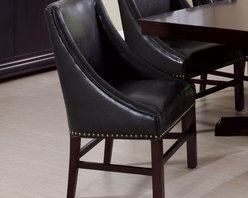 Monarch - Dark Brown Bonded Leather 38in.H Side Chair - Set of 2 - These rich dark brown side chairs are upholstered in a bonded leather featuring an antique brass nail head trim along the base. The unique wing arm styling of the chairs with luxurious padding perfectly compliment the classic sophistication of the dining table.