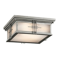 Kichler 2-Light Outdoor Fixture - Stainless Steel Exterior - Two Light Outdoor Fixture. A clean stainless steel finish gives an updated look to this lighting outdoor flush mount ceiling light. From the Portman square collection, the mission lines and modern look are complimented by a soft etched seedy glass shade that pulls the look together. Energy efficient compact fluorescent lamp may be used: not included.