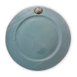 Coquille Charger Plate - Mist - Wonderfully variable tones of silvery blue and seaside grey make the Mist Charger Plate from the Coquille collection a stunning portrayal of cool colors' possibilities for creating flawless d�cor, while the detailed pewter medallion that sets off this fine stoneware charger adds richness to the look of the twice-fired, hand-glazed showpiece.
