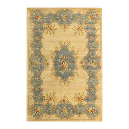 Safavieh - Bergama Brown/Blue Area Rug BRG166A - 6' x 9' - The Bergama Collection includes beautiful reproductions which are hand-tufted to create the same symmetrical knots used in the antique rugs in Safavieh's private archival collection of Peshawar rugs. Made in India, the pure wool rugs in this collection recreate the design and quality of Peshawars made for the top end of the market to a broader base of customers with superior hand tufted quality.