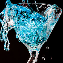 Images by Jon Evan - Over the Top - This photograph depicts the play of color, light and reflection as the liquid spills over the edge of the martini glass. It measures 20x30 and mounted on plexiglass. It comes pre-wired and ready to hang. Sold in a limited edition of 9.
