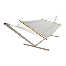 Pawleys Island Linen Textilene Large Poolside Fabric Hammock - You'll be as cool as a cucumber when you relax in the Pawleys Island Linen Textilene Large Poolside Fabric Hammock. The perfect place to lounge poolside - perhaps with a frosty beverage - this hammock has comfort covered in spades. The tightly woven Textilene fabric dries almost instantly so you can relax in comfort (and style) after a dip in the pool. Solid oak spreader bars feature a gorgeous finish that ensures worry-free care and durability. Mildew and fade resistant this baby will keep its beauty for years. With enough room for two it will be easy to find someone to share in the comfort with you. So kick back and enjoy the pool. You've earned it. About Pawleys IslandIn 1889 the Original Pawleys Island Rope Hammock was created at Pawleys Island one of the oldest summer resorts on the South Carolina coast. When river boat pilot Captain Joshua John Ward found the grass-filled mattresses on his boat too hot in the summer he decided to make a cool and comfortable cotton rope hammock to use on his boat. After several uncomfortable designs Cap'n Josh made a hammock using wooden spreaders without knots. This original design has proven to be so comfortable that it's still used in Pawleys Island's popular hammocks over a century later. Pawleys Island continues to use the highest quality materials when making their traditional all-cotton rope spun polyester rope and DuraCord hammocks. Their custom-designed stretcher bars are cut from seasoned Carolina red oak then steamed bent drilled sanded and varnished to impart a comfortable sway to the hammock and to spread the rope evenly for optimum stability. The people of The Original Pawleys Island Rope Hammock are incredibly proud to be anything but new-fangled. Now 120 years old and counting they continue to offer the very best of their past hoping it will help you better enjoy your future.