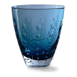 Sea Drops Rocks Glass - Deep Blue - Generously sized for this type, its design inspired by the deep hue and awesome power of the Alaskan Pacific, the Sea Drops Rocks Glass in Deep Blue has a belled shape that gives curve to the landscape of your tableware and life to the simple ritual of sharing drinks. Its cobalt glass is accented with a hand-crafted design of rising bubbles, an ephemeral look of grace.