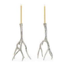 Antler Candlestick Holders - Rustic and glam all at once, a pair of these chic antler candlestick holders would up the style factor of any tabletop and would look terrific off duty on a dining room console as well.