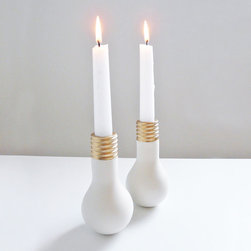 Lightbulb Moment Ceramic Candlesticks - Set of 2 - Are you having a lightbulb moment? We sure are! Made from fine porcelain and finished with gold luster, these pieces illuminate the surrounding area with standard taper candles.