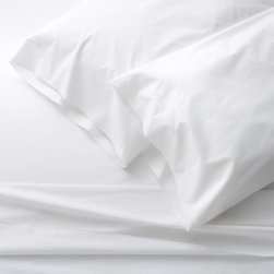 Belo White California King Sheet Set - Clean, basic white bedding upgrades in soft, smooth cotton percale, beautifully accented with a graceful overlocking embroidery stitch on the flat sheet and pillowcase. Generous fitted sheet pockets accommodate thicker mattresses. Sheet set includes one flat sheet, one fitted sheet and two king pillowcases. Bed pillows also available.