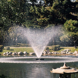 Kasco Marine - 3.1 J Series Decorative Outdoor Fountain - 3.1JF050 - Shop for Fountains from Hayneedle.com! Create a dynamic display in your pond or lake with this dramatic fountain aerator. The 3.1 J Series Decorative Fountain features a decorative low-profile float design for enhanced appearance. It comes with five interchangeable nozzles providing you with the versatility of six different patterns for displays of up to 24 feet in height or 45 feet in diameter. The spray patterns include three geysers a two-tier and two V-shaped funnel patterns. You can easily change nozzles to fit the specific pond dimensions wind conditions and the desired aesthetic effect. (Not pictured: no-nozzle configuration.)In addition to its stunning aesthetic qualities this fountain agitates and spreads oxygenated water throughout your pond or lake. This process discourages algae growth and helps maintain a healthy aquatic environment. The fountain operates successfully at a minimum water depth of 24 inches.The 3.1J Series Fountain has an extremely efficient 240 volt 60 Hz motor. This eco-friendly motor is made of rugged stainless steel and is silicone-sealed against leaks. The fountain is supplied with a state-of-the-art GFCB-protected control panel model C-85. The panel includes a GFCB protection a 24-hour timer surge protection and 120-volt GFI-protected lighting outlet in a rain-proof enclosure. A photoelectric unit-synchronized circuit controls the 120-volt lighting outlet for lights (light kit not included). Kasco recommends a licensed electrician to install the C-85 control panel and the 3.1J fountain if you plan to hard-wire the unit into the C-85 control panel.Features and Benefits of the 3.1 J Series Fountain:Motor: 3HP 1750 RPM 240-volt single phase 60 Hz oil-cooled continuous duty-rated and submersible.Multiple Spray Patterns in One Unit: Custom-configure the unit to your exact needs and preferences. Includes 5 nozzles that let you choose from 6 spray patterns.Efficient Low-P