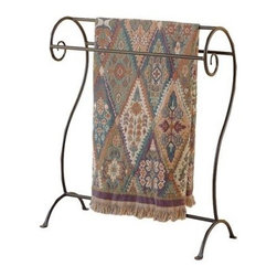 Annalise Quilt Rack - The Annalisa Quilt Rack is constructed of natural black wrought iron. It features beautiful scrolls and can display three quilts or blankets. This high-quality rack is custom-made and is hand-forged by expert blacksmiths in the U.S.A.