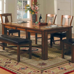 """Steve Silver Lakewood Dining Table - Our Steve Silver Lakewood Dining Table has the perfect blend of traditional rustic and modern elements allowing it to fit in with any decor. It includes an 18-inch leaf that extends the table length to 78 inches so you can comfortably seat up to six people for large family dinners. Constructed of solid hardwood and veneers it has sturdy block legs and the rich oak finish blends well with any color palette. Assembly required. Table dimensions: 60-78L x 42W x 30H inches. This purchase is for dining table only please see """"""""Related Items"""""""" for matching chairs or complete dining set."""