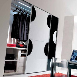 Modern wardrobes Italian furniture  - W 02 - This collection of modern designer bedroom wardrobes and armoires is made in Italy and reflects top Italian quality and design. The first time the wardrobes got alive thanks to these fantastic silk prints on glass doors. You can either enjoy sliding doors or folding doors and a variety of inside equipment for the perfect ultimate modern bedroom wardrobe. Italian design furniture at its best, made in Italy, Imported from Italy. Some of the designs include David, Forest prints, Yin Yang prints , nature prints and multicolored layered designs.