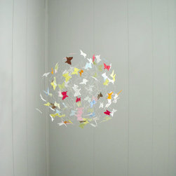 Butterfly Mobile by Butterfly Orbs - How fun would it be to have a little cluster of butterflies in flight in your space? It seems almost magical.