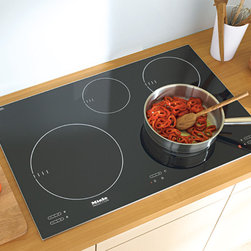 "Miele KM5753  30"" Induction Cooktop - Black - Miele's induction cooktops offer a distinctive, non-contact method of heating using magnetic fields to transfer energy directly to cookware."