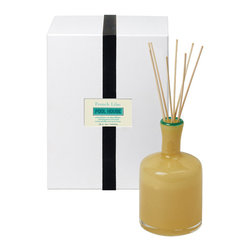 French Lilac / Pool House Diffuser - 15 oz. - A faintly tropical yet wholly traditional aroma of romantic French Lilac combines with the slightest exotic hints of jasmine flowers and essence of rose, making the Pool House Diffuser an airy escape from everyday cares. This floral fragrance diffuser is rendered luxurious by a cylindrical bottle of translucent yellow glass with a striking, vivid green rim around the pale reeds.