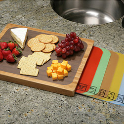 None - Seville Classics Bamboo Cutting Board with PP Cutting Sheets - Protect your counter-top and enhance your productivity in the kitchen with this bamboo and polypropylene cutting board. This stylish cutting board is hard yet lightweight and helps you to speed through kitchen prep so that you can finish faster.