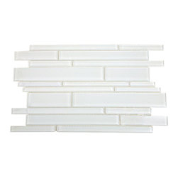 "Tuscany Pattern Super White Glass Tile - Tuscany Super White Pattern Glass Tiles These beautiful mosaics in polished super white is a stunning design. These tiles are mesh mounted and will bring a sleek and contemporary design to any room. This is our brightest white glass on the market. The color is painted on the back of the tiles so it will not scratch or chip. Chip Size: 6""-12"" x .75""-2"" Color: Super White - our bright white Material: Glass Finish: Polished Sold by the Sheet - each sheet measures 11.75"" x 18"" (1.46 sq. ft.) Thickness: 8mm Please note each lot will vary from the next."