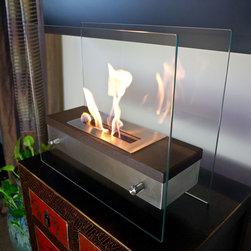 "Bluworld Nu-Flame - Foreste Ardore Portable Tabletop Ethanol Fireplace - Italian for ""fiery passion"", the elegant Foreste Ardore fireplace lives up to its name. A large capacity stainless steel burner is capped with a realistic dark walnut wood finish cover, drawing attention to the dancing flames. The beautiful walnut finish gives a traditional look and feel to an otherwise contemporary design. The burner is suspended between two thick tempered glass panels, which reflect and enhance the fire. Easily adjust the flame height or extinguish it completely with the provided dampener tool. Fuel not included, we recommend using Nu-Flame Bio-Ethanol Fuel. For indoor use only. Foreste Ardore tabletop bio-fireplace may be used indoors or out, however do not leave your fireplace outside exposed to the elements after use."
