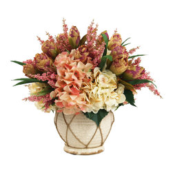 Pink and cream Hydrangeas, Lavender, and roses in large cream pot with twine - This beautiful arrangement has a variety of pink and cream florals including hydrangeas, roses and lavender. The pot is decorated with twine and grass completes the arrangement through out the floral.