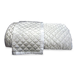 Quilted Throw - It may grace an heirloom chair tucked within a reading alcove replete with classic tales, or it may bedeck a bedscape that invites respite and relaxation and indulgent repose.  A jewel of a bedding accent,  the Quilted Throw presents a diamond quilting pattern on 100% silk charmeuse. A soft lustre allows for ease in blending with a range of textures, fabrics, and color palettes.