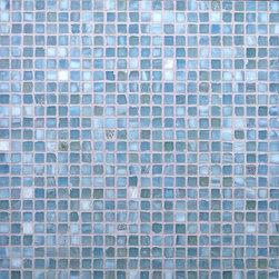 "Glass Tile Oasis - Baby Blue 1/2"" x 1/2"" Blue Pool Frosted Glass - Sheet size:  12 5/8"" x 12 5/8""     Tile Size:  1/2"" x 1/2""     Tiles per sheet:  576     Tile thickness:  1/4""     Sheet Mount:  Paper Face      Sold by the sheet    -  Brilliant glass combed through with coordinating colors and available in 14 mouth-watering colors  in both Iridescent and Frost finishes.Waterfall tiles are hand-poured and will have a certain amount of variation and variegation of color  tone  shade and size. Additionally  you will notice creases  wrinkles  shivers  waves  bubbles topped off with a natural surface to catch all forms of light for a brilliant effect. These characteristics of natural glass and only serve to enhance the final beauty of the installation."