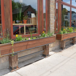 New House Arts - Planter box - Rustic planter boxes of weathering steel, ipe panels and cedar uprights.