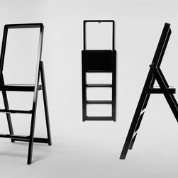 Design House Stockholm 'Step' Step Ladder - Design House Stockholm 'Step' Step Ladder from Stardust.  Functional yet decorative, fairly lightweight, fits nicely in tight spaces, a standalone object in high gloss color. No home is complete without a step ladder, and this modern step ladder is both ultraslim and easy-on-the-eyes. While not in use, Karl Malmvall's 'Step' step ladder folds to just 2 inches! Availalble in high-gloss Red, Black, or White. Supplied with a peg for wall-mounting.  From: http://www.stardust.com/designhousestockholm-step-ladder.html