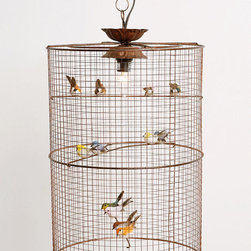 Birdcage Hanging Lamp - This is so sweet and whimsical, I'd buy it immediately if it wasn't for the fact that I know it'd freak my cat out. These sweet little birds (fake of course) will cast soft shadows in this darling, vintage-esque ceiling lamp.