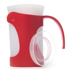 iSi Flex It Pitcher Red - The iSi Basics Flex It Pitcher features a flexible spout for a no mess pour and a beautifully designed and functional handle that's both ergonomic and functional.  A snug fit lid is  included with this 50 Oz. pitcher.Product Features                         Flexible silicone allows you to make your own spout            Snug fit lid included            50 Oz. silicone liner keeps drinks cooler            Comfortable  easy to pour handle            Removable liner for easy cleaning