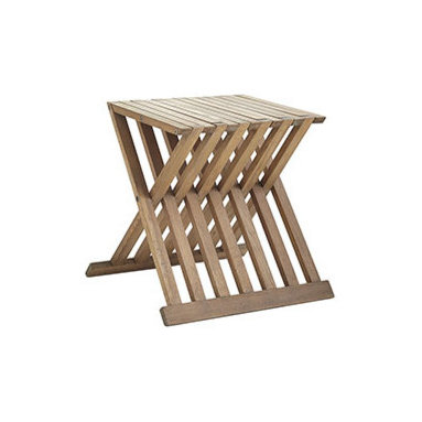 SLATTED FOLDING TABLE - Do away with unsightly outdoor furniture and give your patio an upgrade. This wooden table is great for storage, easily folding up for effortless transport, but the fun design and wooden materials make it easy to blend into sophisticated decor. It's great for parties, family game nights, or wherever you need an extra place to set a drink or to sit. As with any of our pieces, we recommend this be treated before leaving it exposed to the elements to ensure it's longevity and looks.