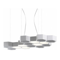 "Luceplan - Luceplan Honeycomb 6 Modules Pendant Light - The Honeycomb 6 modules pendant light has been designed by Habits Studio for LucePlan. A seemingly random composition of injection-moulded technopolymer hexagonal modules takes on the form of modular suspension lighting. The system evokes the geometric and repetitive rigout of a beehive, but allows notable creativity in determining the desired form in keeping with the custom-made concept of this collection. The modules, which are hooked together with small plastic clips, bring to life a  self-supporting structure capable of housing a variety of light source: from low-voltage halogen bulb to highly efficient LEDs, from prefocalized source fro accent lighting to omnidirectional source fro soft  direct or indirect lighting. Light and structure are designed as independent elements: in fact, one may decide to outfit only some modules with light sources, freely alternating the composition of lighting elements or not, with infinite possibilities. Product description:  The Honeycomb 6 modules pendant light has been designed by Habits Studio for LucePlan. A seemingly random composition of injection-moulded technopolymer hexagonal modules takes on the form of modular suspension lighting. The system evokes the geometric and repetitive rigout of a beehive, but allows notable creativity in determining the desired form in keeping with the custom-made concept of this collection. The modules, which are hooked together with small plastic clips, bring to life a  self-supporting structure capable of housing a variety of light source: from low-voltage halogen bulb to highly efficient LEDs, from prefocalized source fro accent lighting to omnidirectional source fro soft  direct or indirect lighting. Light and structure are designed as independent elements: in fact, one may decide to outfit only some modules with light sources, freely alternating the composition of lighting elements or not, with infinite possibilities. This kit includes 9 bodies, 4 steel cables, 13 attachments, and either halogen or LED modules.  .Details:      Manufacturer: LucePlan   Design:  Habist Studio       Made in: Italy   Dimensions:  Length: 12"" (30.4 cm) X Widht: 9.3"" (23.6 cm)        Light bulb: 6 x Max 8W LED 2700 K or 3 x GY6.35 Max 35W Bi-Pin T-3 Halogen     Material  Aluminum, polycarbonate glass white"