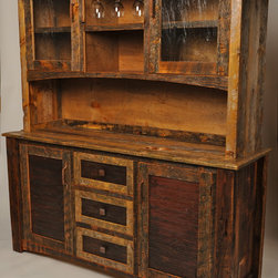 Rustic Furniture Portfolio - This buffet hutch features rusted and recycled corrugated metal panels for the lower cabinet doors and drawer fronts.  Upper glacier glass doors and an open stemware holder are shown above.  All cabinets include adjustable shelves and the drawers are riding on full extension ball bearing slides.