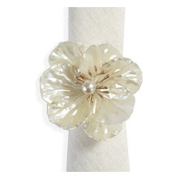 Z Gallerie - Carolina Napkin Ring - Set of 4 - Add elements of softness to your tabletop with our Carolina Napkin Ring.  Delicately crafted in the shape of a stunning floral, each petal is intricately detailed with texture for light to play against. Finished in a linen white hue gives dimension and a luminescent quality to the flower. Pair with a wide variety of napkins for an effortlessly chic combination. Sold as a set of four.