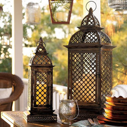 Casablanca Filigree Metal Lanterns - The pierced metal and bronze color is so reminiscent of Morocco. These would look gorgeous as part of a tablescape.  Dimensions vary. Price ranges from $59 to $99.