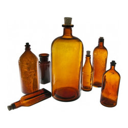 Amber Glass Bottles - Set of seven vintage amber glass bottles including Clorox, Duffy Malt Whiskey andFather John's Medicine.