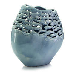 Fish Schools Vase - Making the play of light a part of its inherent design, the seed-shaped Fish Schools Vase is half solid and glazed with cloudy aqua blues, half detailed with a scintillating representative cutwork modeled into a flood of fish that appear to move around the vase's body.  Excellent for leaves, succulents, and empty display, this cool-toned vase is an instant treasure.