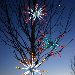 """Holidynamics - Christmas Product - 24"""" LED Starburst are perfect when christmas decorating trees.  Each starburst has a 10' lead cord to help space out the starburst in the trees while having a main power source point.  Starburst fold down for each storage."""