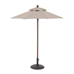 Round Market Umbrella with Eucalyptus Pole, 6', Solid, Stone - Vibrant, sun-drenched colors make these umbrellas summer favorites. Choose from our three types of poles to help you complement outdoor furnishings. 6' diameter, 7.4' high 9' diameter, 8.25' high Choose eucalyptus, teak or aluminum pole. Wood pole is crafted from eucalyptus or premium teak, and features an easy-to-use pulley system, and three positions for the galvanized-metal locking pin that keeps the umbrella open. Sturdy aluminum pole in bronze finish has an easy-turn crank handle and tilt function. Designed to fit any Pottery Barn outdoor dining table that accommodates an umbrella. Please check umbrella pole diameter if using with other tables. Concrete stand (sold separately) can be used with any of our umbrellas for added stability. Simple assembly. Imported. Natural and Ink Blue are Catalog / Internet only. View our {{link path='pages/popups/fb-outdoor.html' class='popup' width='480' height='300'}}Furniture Brochure{{/link}}.