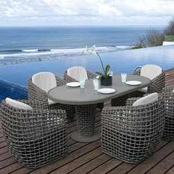 Dynasty Oval Dining Table from Skyline Design - The Dynasty Outdoor Dining Collection with Oval Table features a unique and elegant design, indicative of the innovation and quality that has made Skyline Design the leader in luxury outdoor furniture.  Integrating the finest synthetic weaving materials with strong aluminum frames, Skyline Design creates furniture that is as beautiful as it is durable.  Utilizing revolutionary high-density polyethylene weaving material, Skyline Design furniture is high-tensile strength, chemical and UV resistant, all-weather proof furniture that is safe for the environment and 100% recyclable.