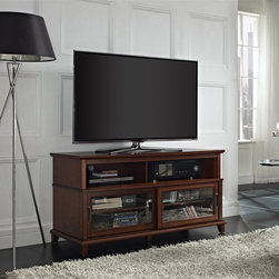 None - Deacon Madison Cherry TV Console with Sliding Glass Doors - Bring an attractive accent piece to your living room,den or family room space with the Deacon TV console,finished in Madison Cherry. Capable of holding a flat panel TV up to 48 inches,this sturdy stand features two sets of knobs for customization.