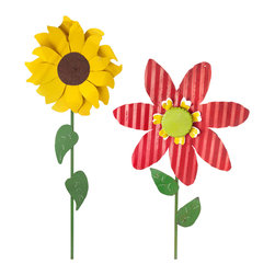 OVERSIZED TIN FLOWERS - These yard stakes are colorful and fun. The over-sized shape brings a cartoon-like feel to the flowers. The stripes in the zinnias are completely improbable but totally fun. Plus, they're hand made by an artist in Georgia, my home!