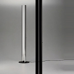 "Artemide - Megaron floor lamp - Product Details:   The Megaron floor lamp from Artemide has been designed by Gianfranco Frattini. This floor lamp is perfect for indirect halogen lighting. This floor standing luminaire has a two section body in extruded aluminum with a polished natural aluminum finish or glossy black finish. The Megaron also incorporates a high efficiency reflector in anodized aluminum. This floor lamp with its sleek design is the perfect accent to any contemporary environment. Slide dimmer control lever incorporated in body.  Details:                                Manufacturer:               Artemide                                  Designer:                            Gianfranco Frattini                                                Made in:              Italy                                  Dimensions:                             Height: 71.75"" (182 cm) X Width: 13.75"" (35 cm)                                                 Light bulb:                             1 X 300W halogen                                                 Material:               aluminum, steel"