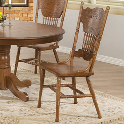 Coaster - Brooks Dining Chair, Oak - Set of 2 - This beautiful dining table and chair set will be a lovely addition to your breakfast nook or casual dining room. The smooth oval oak table top features a beveled edge and plain apron. A pretty turned pedestal base gives this piece just the right touch of traditional charm. The traditional oak chairs will fit nicely into your room, with splat backs featuring an intricate pressed design and turned supportive spindles. Turned legs complete these chairs, in a beautiful oak that will blend with your decor.